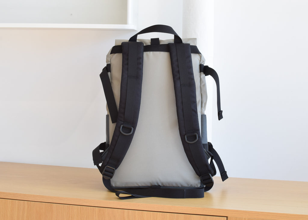The Topo Designs Rover Pack in Silver/Charcoal from the back with adjustable straps.