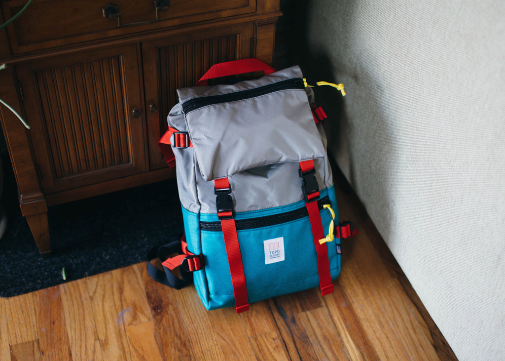 Topo Designs Rover Pack in Turquoise/Silver packed and ready for travel.