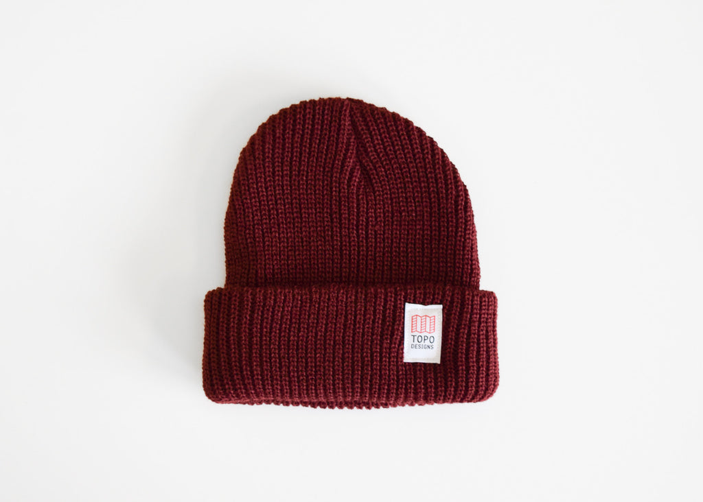 The Topo Designs Watch Cap in burgundy.