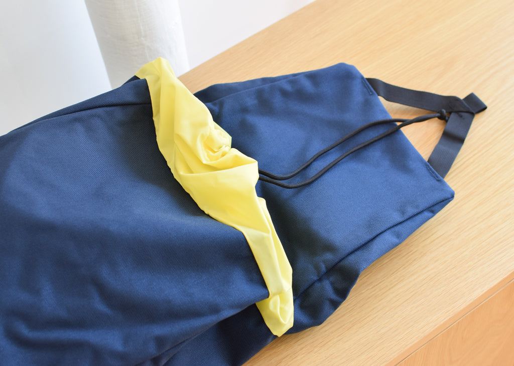 The Topo Designs Y-Pack in navy with drawstring closure from Commonplace.
