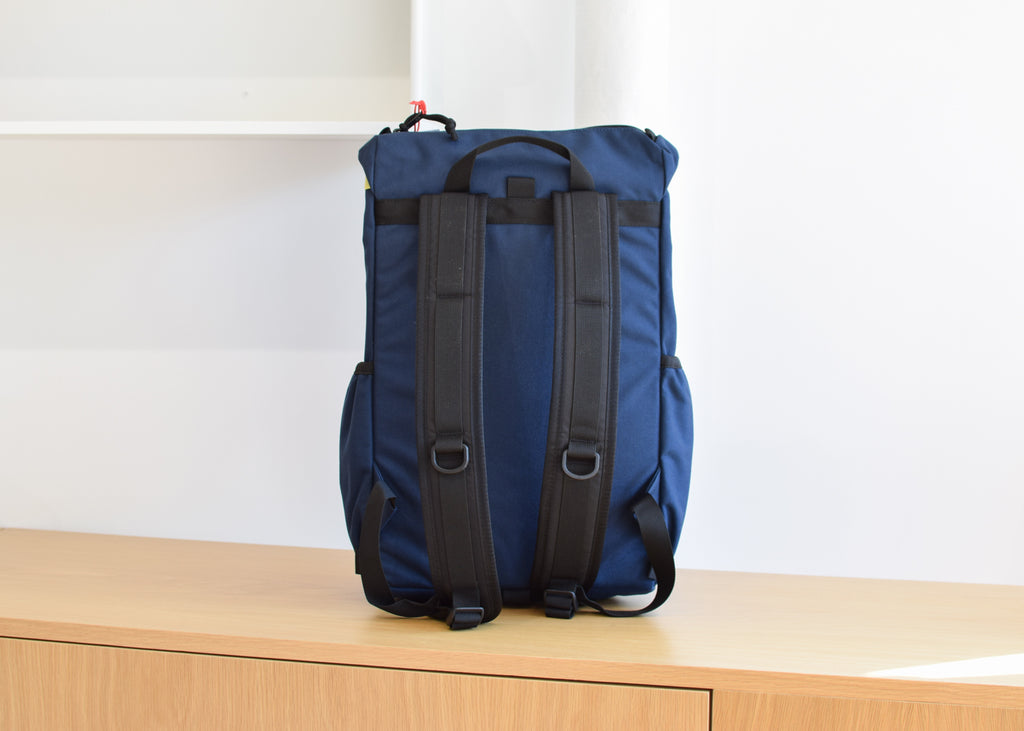 The Topo Designs Y-Pack in navy with padded straps from Commonplace.