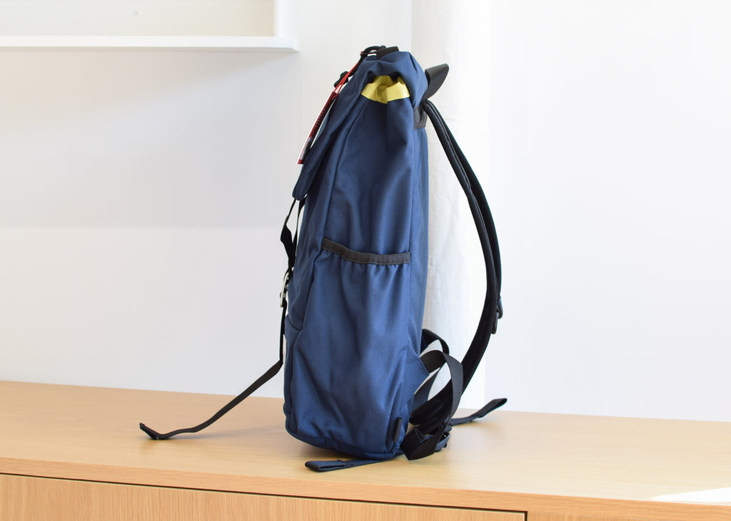 The Topo Designs Y-Pack in navy with side pockets from Commonplace.