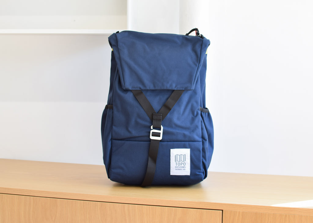 The Topo Designs Y-Pack in navy from Commonplace design and accessories shop.