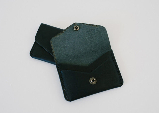 Open view of the Winter Session handmade leather Snap Wallet in black.