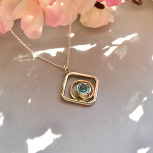 Sterling Silver and 9ct Yellow Gold Blue Topaz Pendant