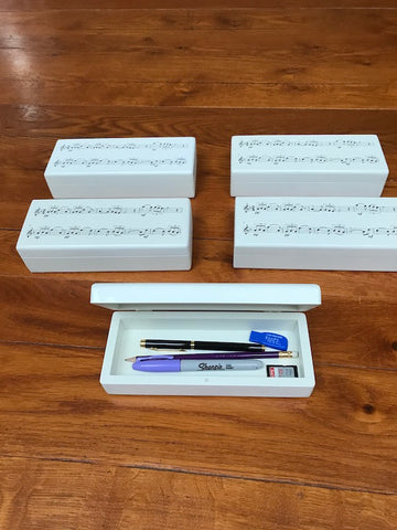 Personalised white wooden pencil case with music notes design (£21 plus VAT)