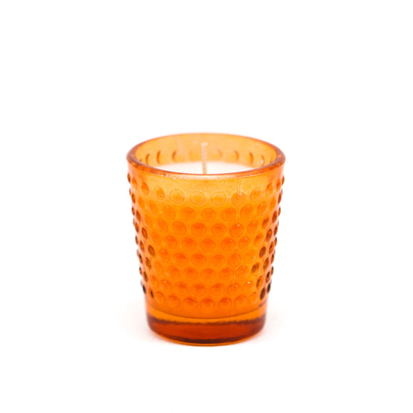 Candle in a glass dish with orange aroma