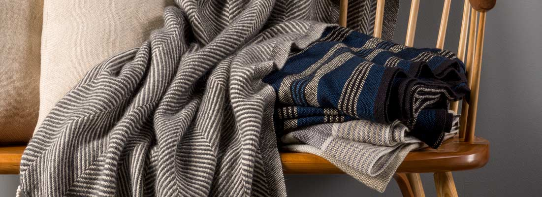 <p>Our cotton-wool throws bring lush comfort with impeccable softness. Premium wool and cotton yarns are spun from our long tradition of handloom, creating a luxurious, cozy companion.</p>