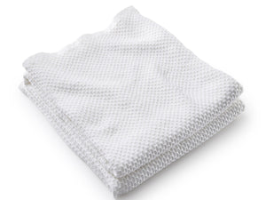 Harmony White folded blanket.