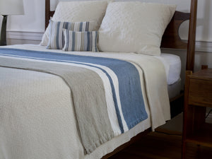 Edgecomb White blanket shown on bed.