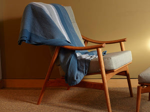 Blue Heron blanket thrown on a wooden chair