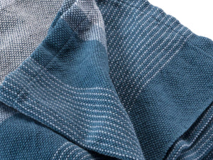 Blue Heron folded cotton throw close-up image.