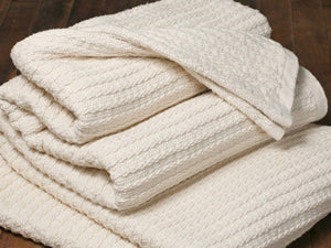 Stack of Bethel Natural blankets.