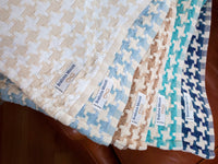Stack of Bucksport throws showcasing all the color variations.
