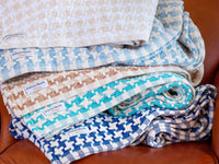 Stack of folded Bucksport throws showcasing all the color variations.