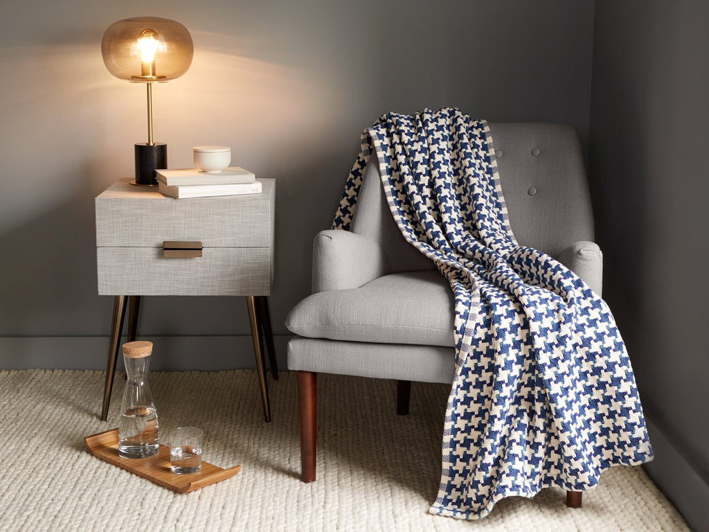 Bucksport Indigo blanket thrown on a chair.