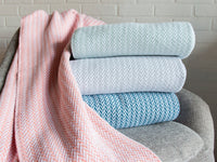 Stack of Chebeague throws showing the color variations.
