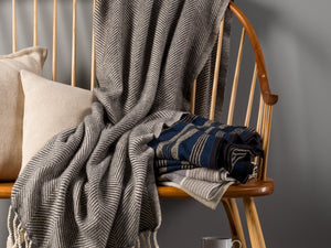 Islesboro Natural Slate blanket thrown on chair.