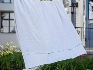 Milo White blanket hanged on a wire.