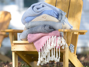 Stack of Monhegan throws on a chair.