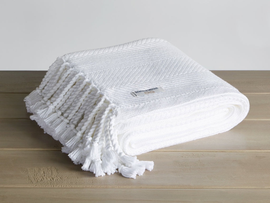 Monhegan White folded blanket.
