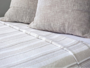 Newport Oyster/Stone blanket on bed.