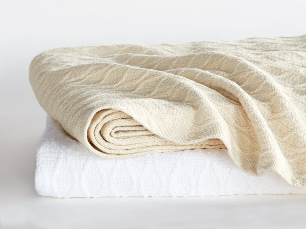 Stack of Oxbow folded blankets.