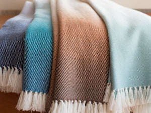 Palermo wool throws layered on top of each other.