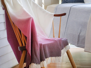Palermo wool blanket thrown on a chair.