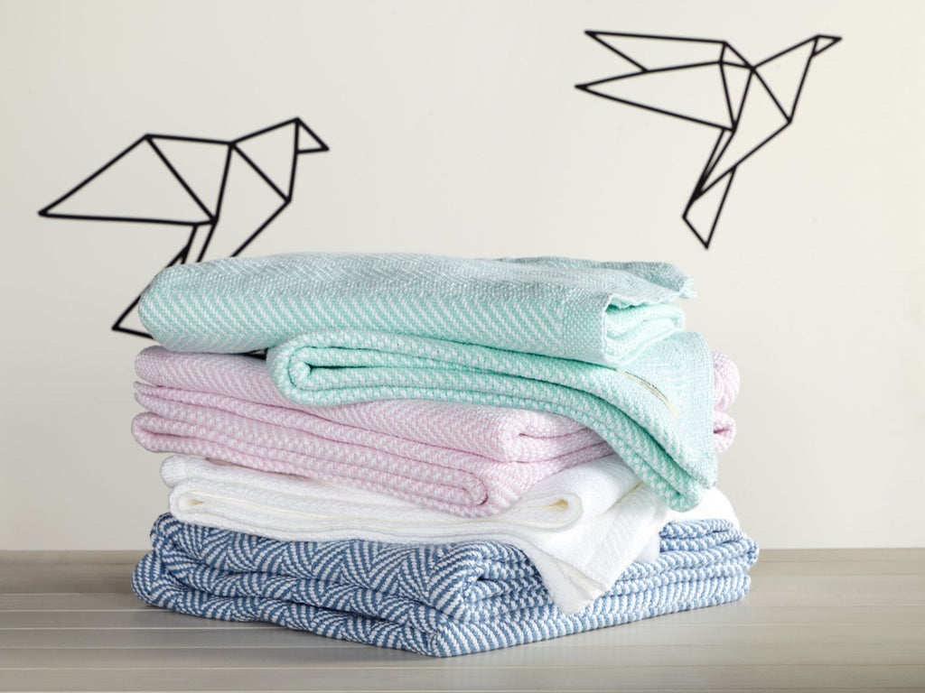 Stack of Penobscot baby blankets in all color variations.