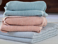 Stack of Penobscot cotton blankets.