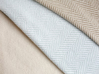 Layered Penobscot blankets in three color variations.
