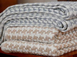 Stack of Rockport folded throws.