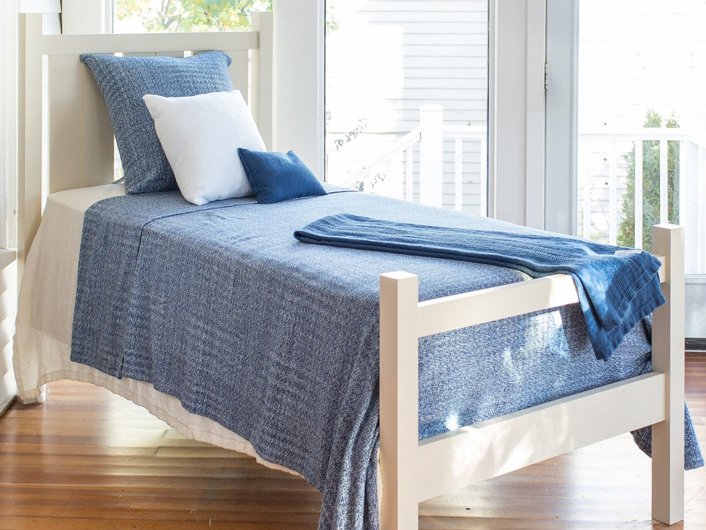 Sebasco Indigo blanked laid out on bed.