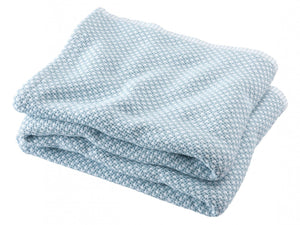 Edgecomb Shore folded blanket.