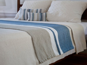 Harbor Day blanket placed on bed.