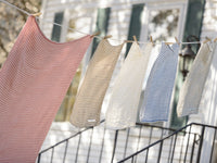 McClary towels in different colors hanged on a wire.