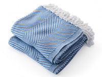 Monhegan White/Baja Blue folded throw.