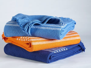 Stack of Pembroke throws in all color variations.