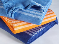 Stack of Pembroke throws in all color variations close-up image.