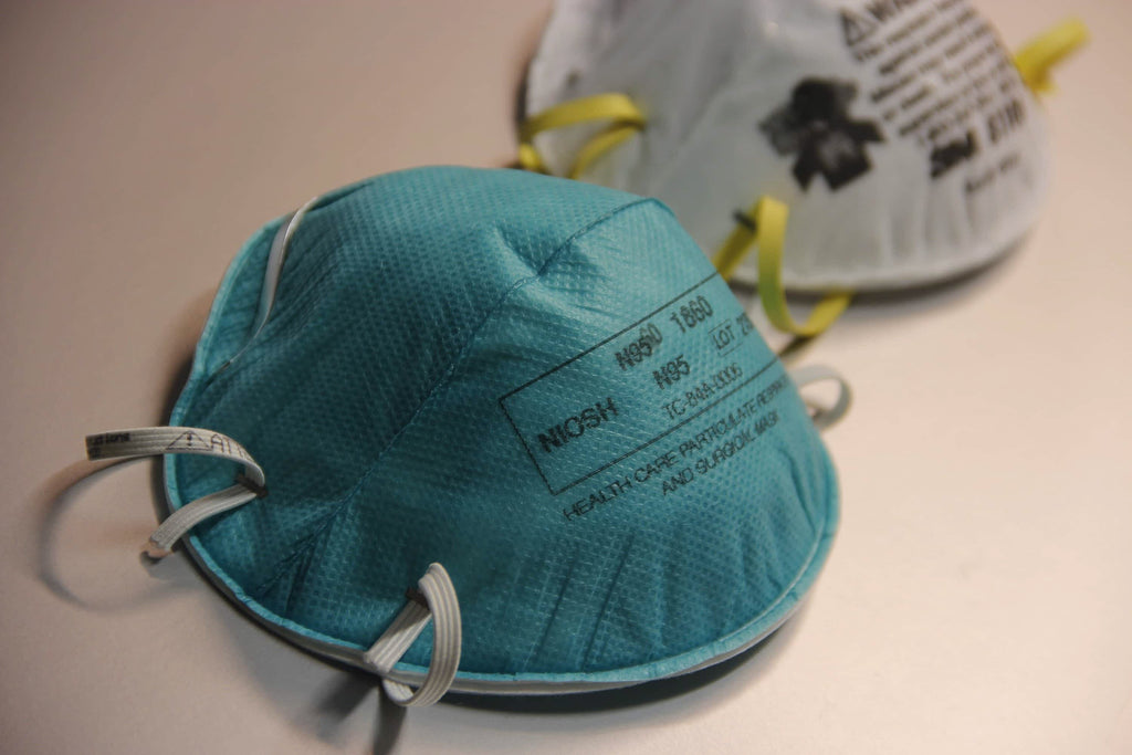 a blue and white N95 respirator mask