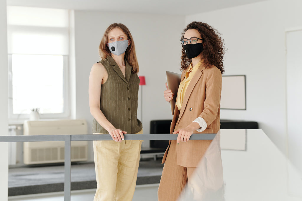 two women standing and wearing N95 respirator mask