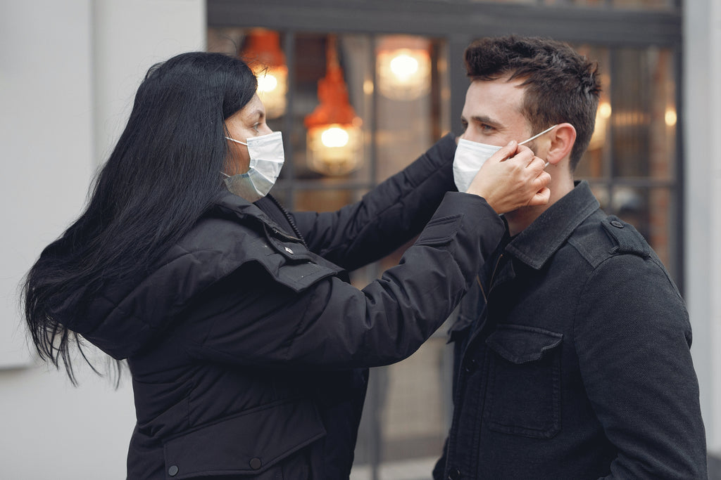 two people wearing black jacket and face mask