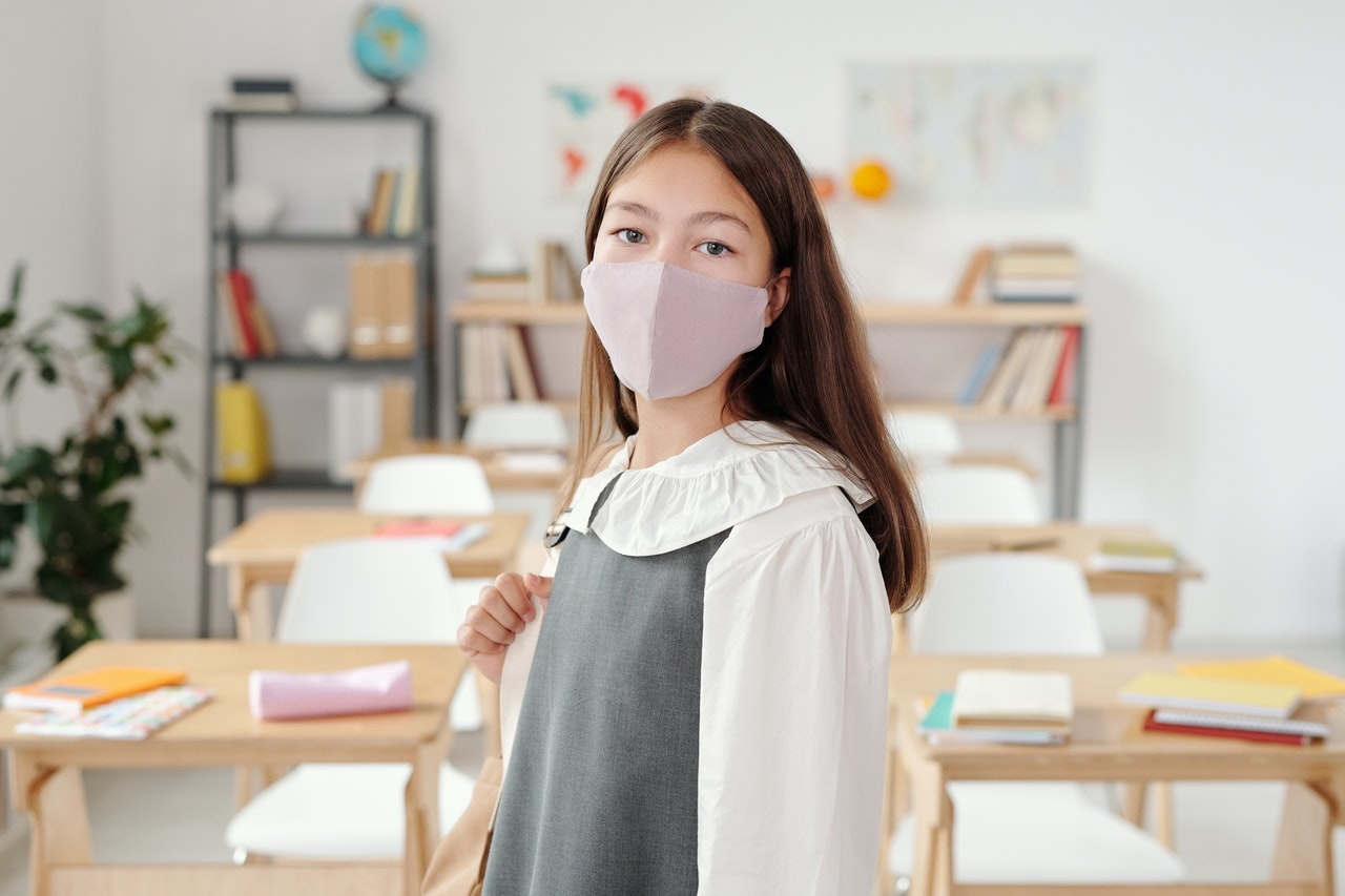 school girl wearing flushields face mask