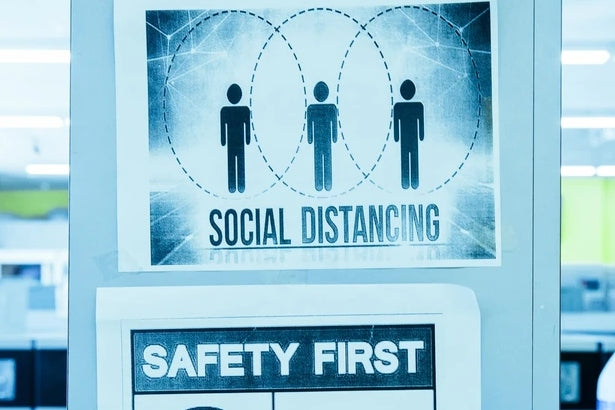 A sign saying social distancing