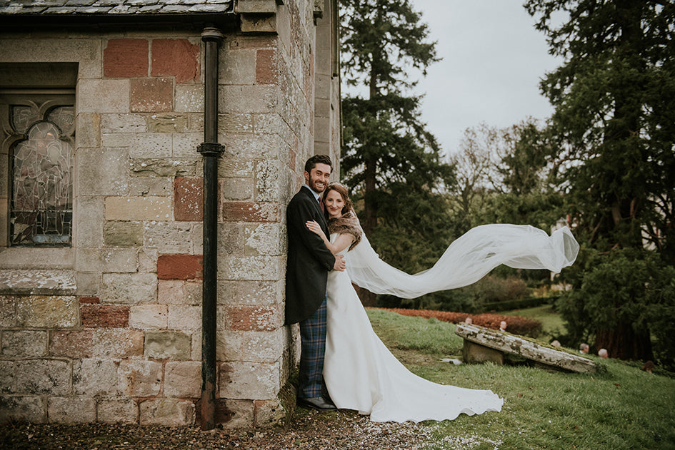 Wedding photo with veil in wind