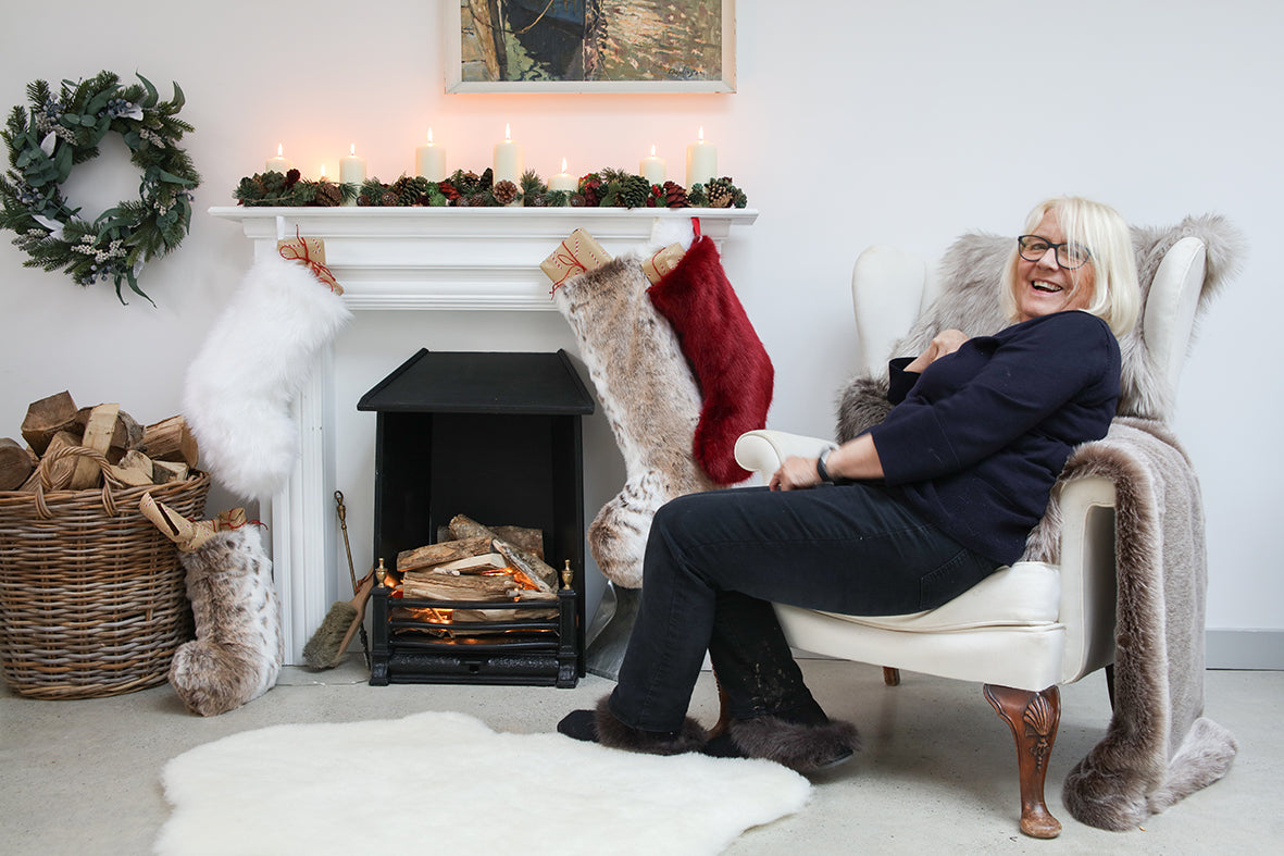 Helen Moore and Christmas Stockings on fire place