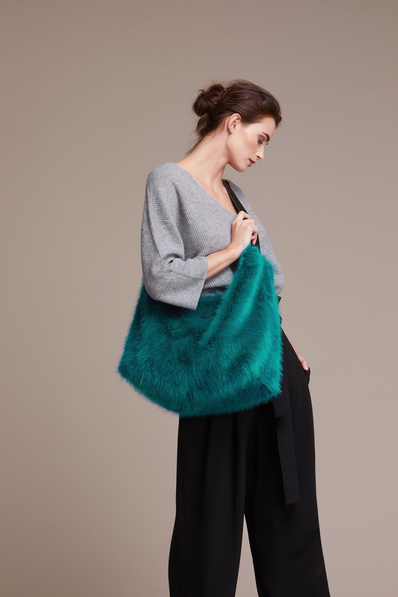 large faux fur weekend bag by helen moore in green fabric