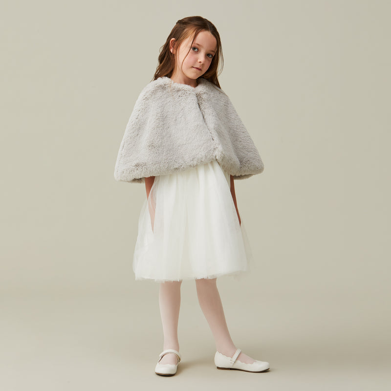 Child wearing pale grey mist clud children's short cape by Helen Moore