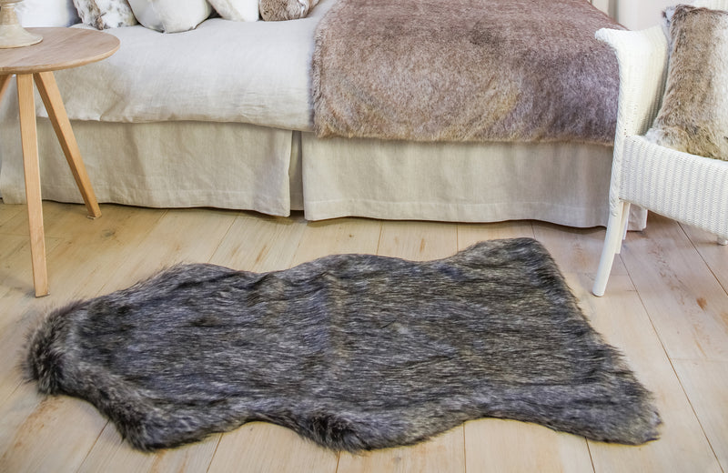 Grey and black faux Fur Animal floor rug by Helen Moore